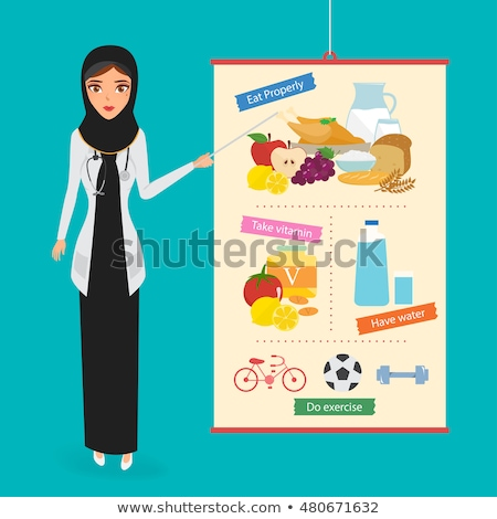 Medical doctor checking health of Football on white background Stock photo © tab62