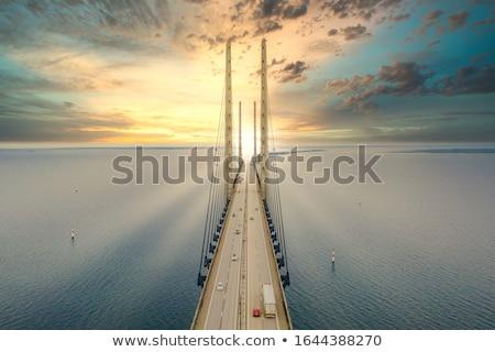 Kilátás híd Svédország Dánia naplemente üzlet Stock fotó © vladacanon
