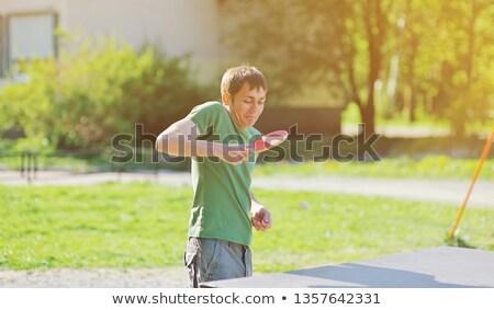 An Asian boy playing tabletennis Stock photo © bluering