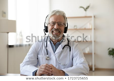 Portrait of senior doctor looking at camera stock photo © nyul