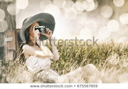 Kız oturma bavul genç kadın paketlemek kadın Stok fotoğraf © superelaks