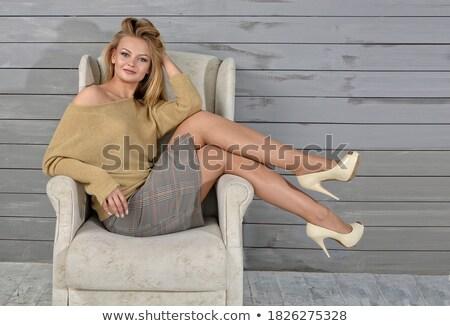 Femme longues jambes chaise en bois isolé blanche sexy Photo stock © Nobilior