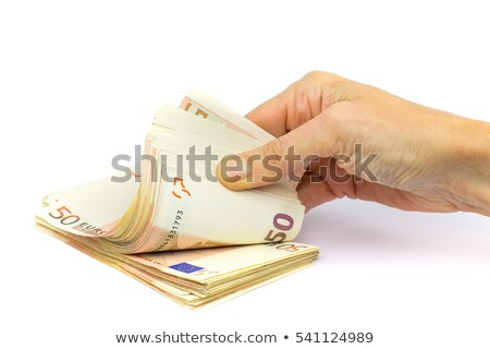 Сток-фото: Hand Holding Stack Of Fifty Euro Notes On White