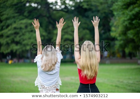 two friended women sisters against sky white background outdoors stock photo © artfotodima