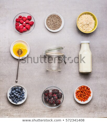 Yoghurt with goji berries, chia seeds and honey Stock photo © user_11224430