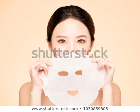 Prettyl woman with facial mask at beauty salon. Spa treatment Stock fotó © Yatsenko