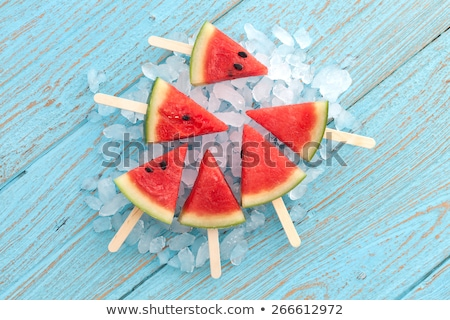 Tasty watermelon popsicle yummy fresh summer fruit on white wood Stock photo © Yatsenko