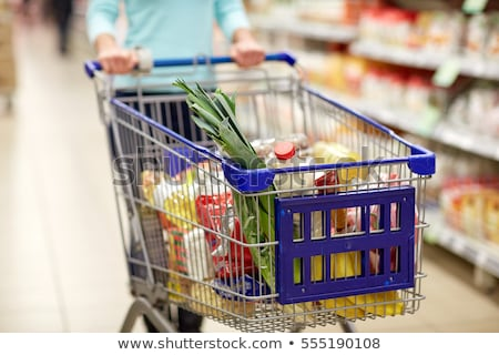 Fruits in shopping trolley in supermarket. Stock photo © deandrobot