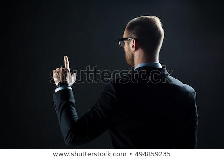 ver · de · volta · empresário · indicação · dedo · branco · sensual - foto stock © dolgachov
