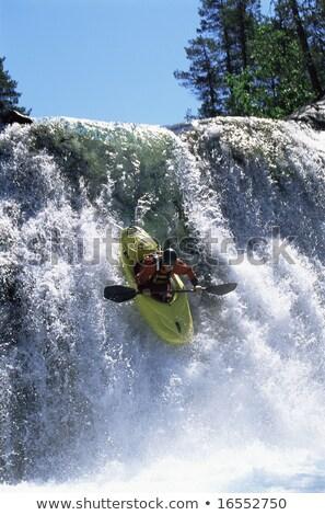 fiatalember · kajakozás · folyó · víz · erdő · kövek - stock fotó © monkey_business