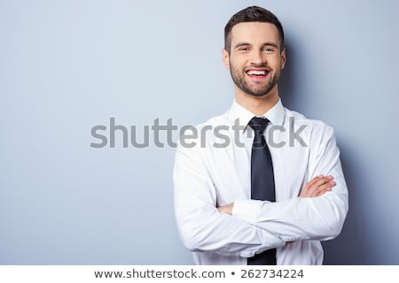 Stock photo: Portrait of a young cheerful businessman