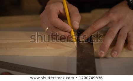 carpenter handyman sharpening pencil with pocket knife stock photo © stevanovicigor