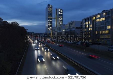ストックフォト: Busy Road With Office Building In Munich Germany During The Blue Hour