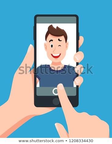 man taking photo of friends stock photo © lightfieldstudios