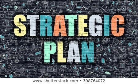 strategic plan concept multicolor on dark brickwall stock photo © tashatuvango