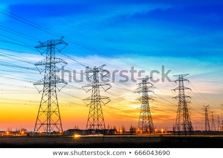 high voltage poles with wires Stock photo © OleksandrO