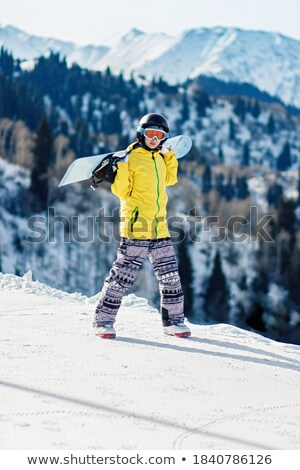 female snowboarder walking with her snow stock photo © is2