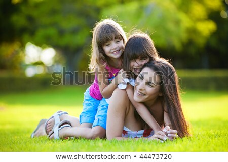 woman gardening with two children stock photo © is2