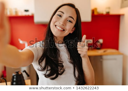 Cheerful young Asian girl Stock photo © elwynn