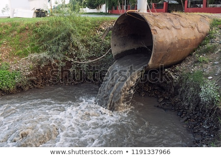 Industrial waste from pipe. Sewage Flow. Environmental pollutio Stock photo © MaryValery