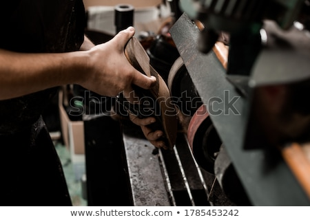 Shoemaker grinding the sole of the shoe Stock photo © IS2