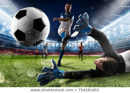 goalkeeper with ball at football goal on field Stock photo © dolgachov