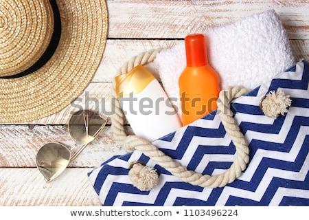 garrafa · creme · queimadura · de · sol · plástico · areia · praia - foto stock © magraphics