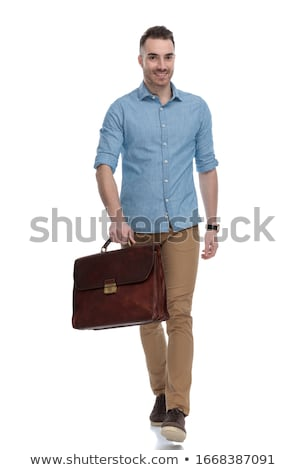 Sorridente jovem casual homem caminhada para a frente Foto stock © feedough