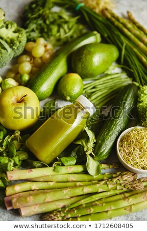 Green antioxidant organic vegetables, fruits and herbs placed on gray stone Stock photo © dash