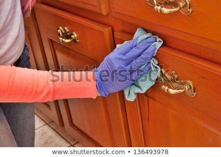 Janitor Cleaning Furniture With Cloth Stock photo © AndreyPopov