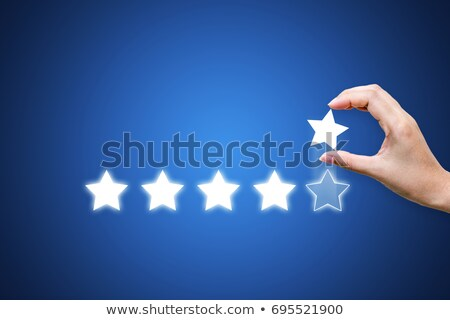 hand putting star symbol to increase rating of app stock photo © jossdiim