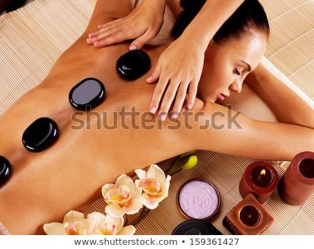 beautiful woman having hot stone therapy at spa Stock photo © dolgachov