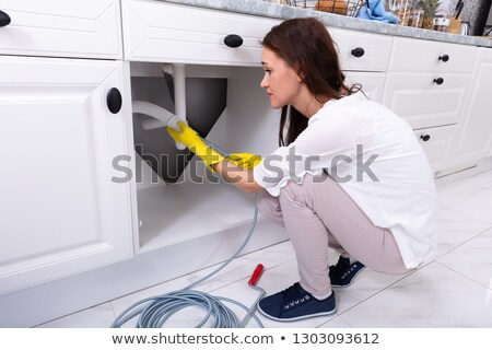 woman cleaning clogged sink pipe stock photo © andreypopov
