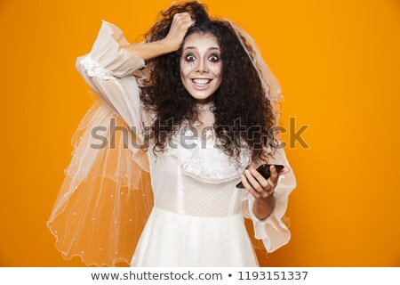 Image of happy zombie woman on halloween wearing wedding dress a Stock photo © deandrobot