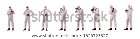 forensic specialist in protective suit taking photos on white stock photo © elnur