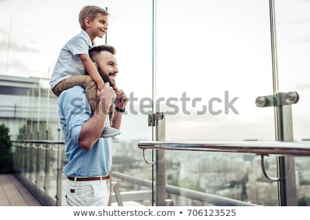 Happy father spending time with his little son at the park Stock photo © deandrobot