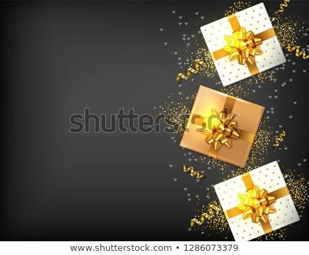 Ajándékdobozok arany íj vektor valósághű sötét Stock fotó © frimufilms