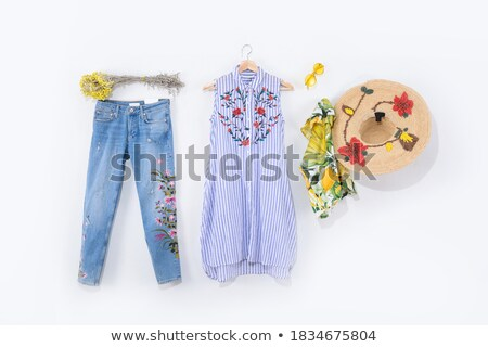 Vertical image of woman in dress, straw hat and sunglasses Stock photo © deandrobot