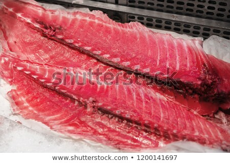 fresh tuna fish or seafood on ice at makret stall Stock photo © dolgachov