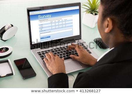 Işkadını doldurma çevrimiçi anket form dizüstü bilgisayar Stok fotoğraf © AndreyPopov