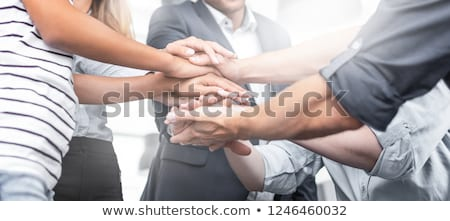 Group Of Colleague In Meeting Raising Their Arms Stock photo © AndreyPopov
