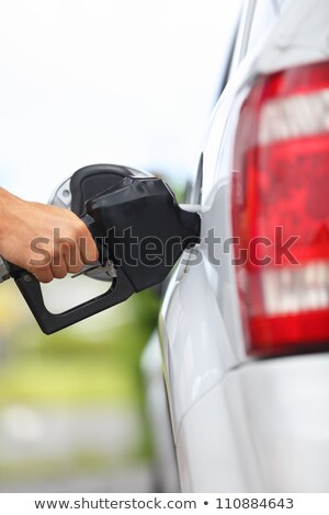 gas station pump man filling gasoline fuel in car holding nozzle close up stock photo © maridav