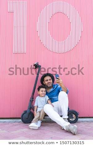 Man Sitting On Electric Scooter Taking Selfie Stock photo © AndreyPopov