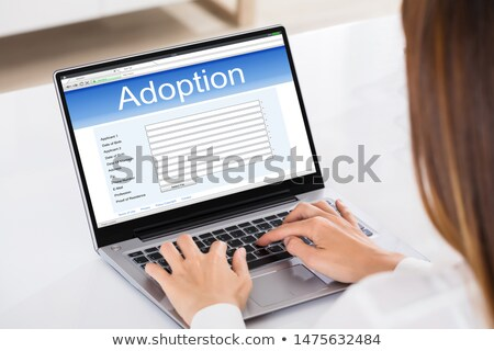 Woman Filling Adoption Paternity Registry In Laptop Stock photo © AndreyPopov