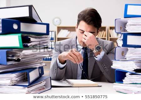 The businessman with excessive work paperwork working in office Stock photo © Elnur
