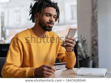 Man looking at mobile phone  Stock photo © szefei
