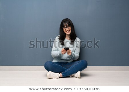 Pretty young woman seated Stock photo © rcarner