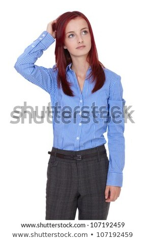 Stock photo: Redhead businesswoman scratching her head