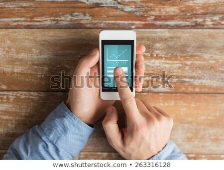 Vendite classifiche top cellulare mano maschio Foto d'archivio © ra2studio