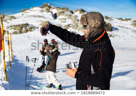 girl snowboarders having apres beers stock photo © is2
